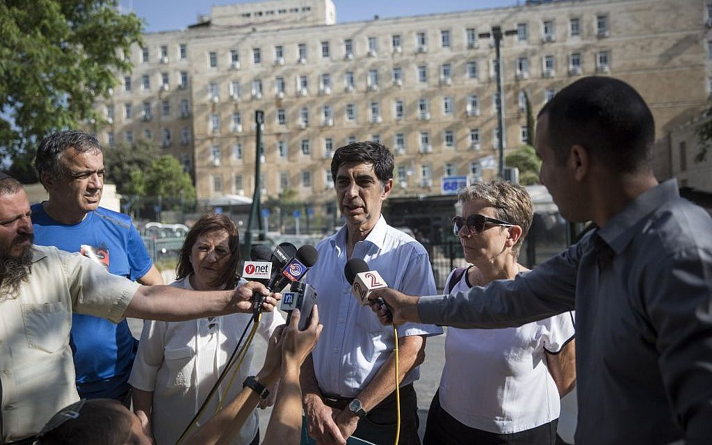 The parents of Hadar Goldin and Oron Shaul speak to the media in Jerusalem on June 28, 2016. (Hadas Parush/Flash90)