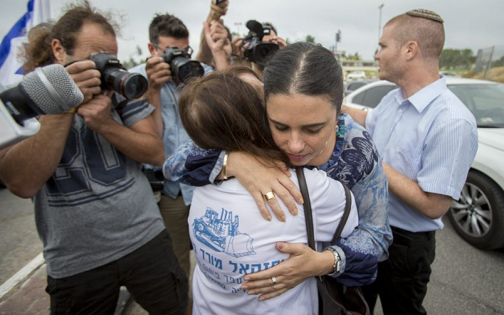 Justice Minister Ayelet Shaked hugs the mother of late Israeli soldier Oron Shaul outside the Prime Minister's Office during a protest against the agreement with Turkey outside the cabinet meeting, in Jerusalem, June 29, 2016. (Yonatan Sindel/Flash90)