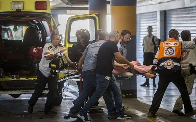 Medics wheeling Hallel Yaffa Ariel, fatally injured in a West Bank stabbing attack, into Jerusalem's Shaarei Zedek Medical Center on June 30, 2016. (Yonatan Sindel/Flash90)