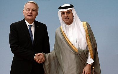 French Foreign Minister Jean-Marc Ayrault shakes hands with Saudi Foreign Minister Adel al-Jubeir prior to an international meeting to revive the Israeli-Palestinian peace process in Paris, France, Friday, June 2, 2016. (Stephane de Sakutin/Pool Photo via AP)