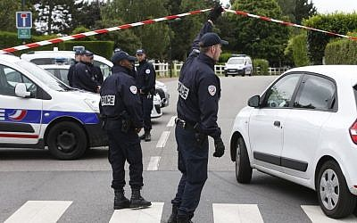 French police officers work at the crime scene the day after a knife-wielding attacker stabbed a senior police officer to death Monday evening outside his home in Magnanville, west of Paris, France, Tuesday, June 14, 2016. (AP Photo/Thibault Camus)
