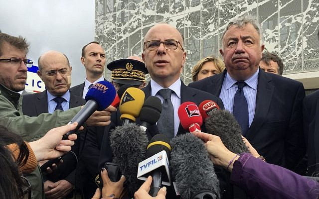 French Interior Minister Bernard Cazeneuve answers reporters after visiting the police station in Les Mureaux, west of Paris, Tuesday, June 14, 2016. (AP/Nadine Achoui-Lesage)