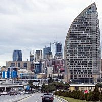 In this Feb. 19, 2016, file photo, The Trump International Hotel, the highest building, is seen in Baku, Azerbaijan. (AP Photo/Aida Sultanova, File)