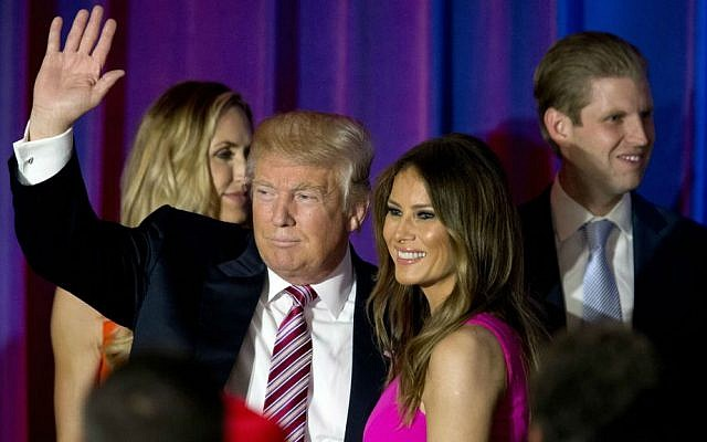 Republican presidential candidate Donald Trump waves at supporters as he leaves the stage with his wife Melania after a news conference at the Trump National Golf Club Westchester, Tuesday, June 7, 2016, in Briarcliff Manor, New York. (AP Photo/Mary Altaffer)
