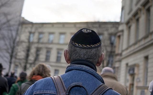 A man wearing a kippah as he takes part in a silent march in Berlin to commemorate the 75th anniversary of the Kristallnacht pogroms, Nov.  9, 2013. (Carsten Koall/Getty Images via JTA)
