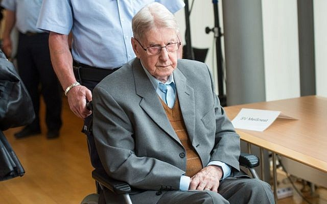 94-year-old former SS guard at the Auschwitz death camp Reinhold Hanning, arrives at a courtroom in Detmold, Germany, Saturday June 11, 2016. (Bernd Thissen/Pool Photo via AP)