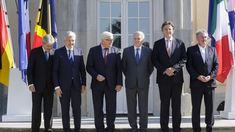 Foreign Ministers from EU's founding six, from left to right, Paolo Gentiloni from Italy, Didier Reynders from Belgium, Frank-Walter Steinmeier from Germany, Jean-Marc Ayrault from France, Bert Koenders from the Netherlands and and Jean Asselborn from Luxembourg, pose for a group photo prior to a meeting in Berlin, Saturday, June 25, 2016. (AP Photo/Markus Schreiber)