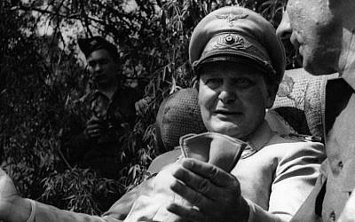 Hermann Goering speaking with a foreign journalist in his private garden in Augsburg, Germany, May 13, 1945. (JTA/Getty Images)