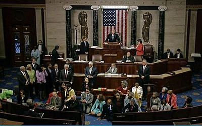 In this frame grab taken from AP video Georgia Rep. John Lewis, center, leads a sit-in of more than 100 Democrats in demanding a vote on measures to expand background checks and block gun purchases by some suspected terrorists. (AP)