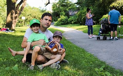 Steven I. Weiss with his two sons. (Humans of New York/Facebook via JTA)