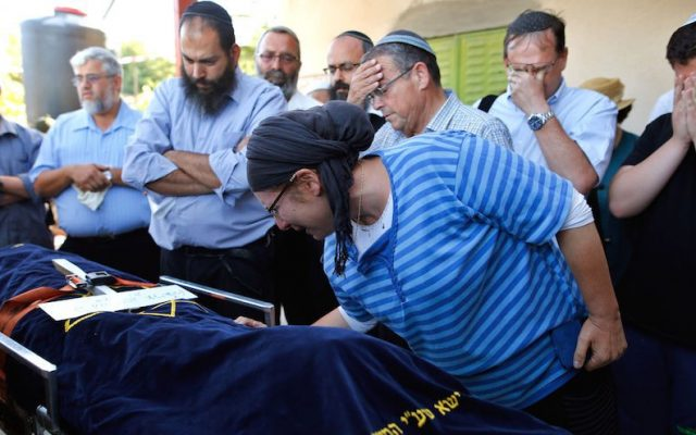 Rina, the mother of Hallel Yaffa Ariel, a 13-year-old girl who was fatally stabbed by a Palestinian terrorist in her home, mourns over her daughter's body during her funeral in the Kiryat Arba settlement, on June 30, 2016. (Gil Cohen-Magen/AFP/Getty Images)