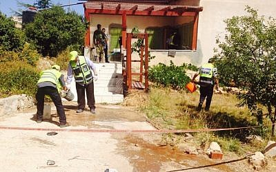 ZAKA volunteers at the scene of a terror attack in Kiryat Arba, on June 30, 2016, in which a 13-year-old girl was stabbed to death in her bedroom. (Nati Shapira)