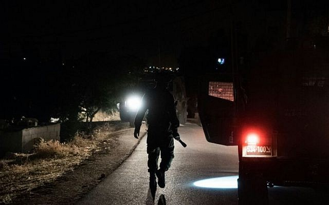 IDF troops surround the West Bank town of Yatta, the home of two terrorists who carried out a deadly shooting attack in Tel Aviv's Sarona Market, June 9, 2016. (IDF Spokesman)