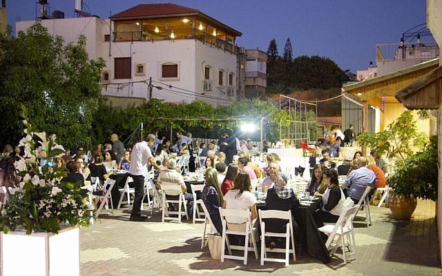 Illustrative: Jews and Arabs sharing an Iftar (break-fast) meal together during the month of Ramadan, in the town of Tayibe, June 9, 2016. (Dov Lieber/Times of Israel)