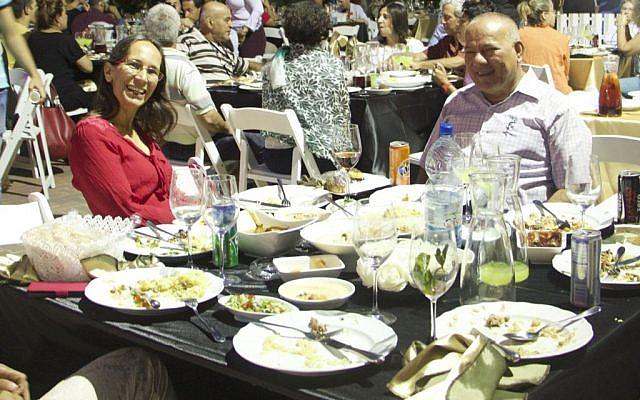 Tachsim Jaber (right) and Ravit Boged (left) eating together. (Dov Lieber / Times of Israel)