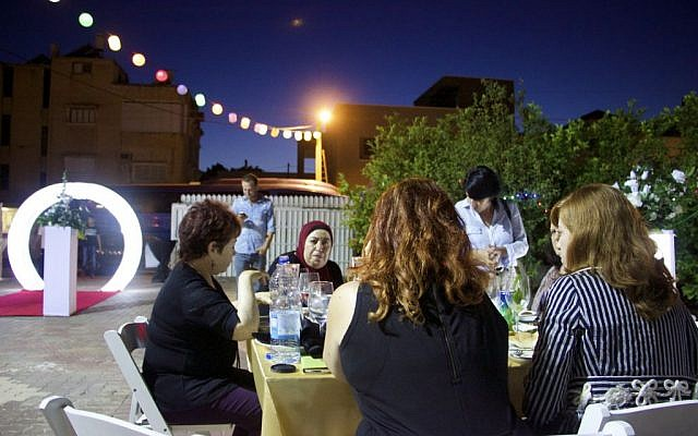 Jews and Arabs sharing an Iftar (breakfast) together during the month of Ramadan, in the town of Taybeh, June 9th, 2016. (Dov Lieber / Times of Israel)