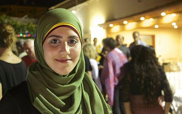 Amena Massarwe, 23, who played the primary hostess for a joint Muslim-Jewish Iftar in the town of Tayibe, June 9, 2016. (Dov Lieber / Times of israel)