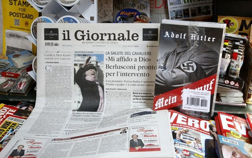 Il Giornale newspaper is seen on sale in a newsstand with Hitler's 'Mein Kampf,' in Rome Saturday, June 11, 2016. (AP/Fabio Frustaci)