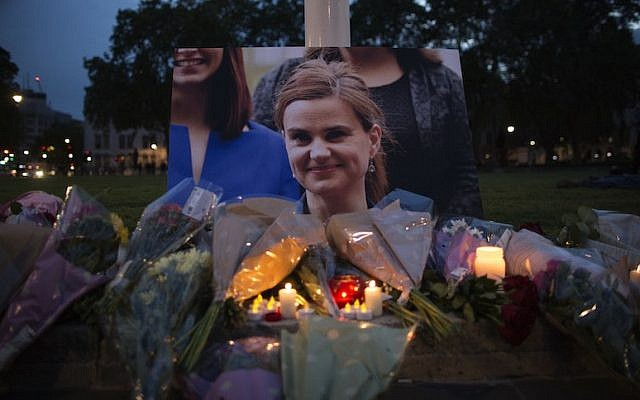 Flowers surrounding a picture of Jo Cox during a vigil in Parliament Square in London, England, June 16, 2016. (JTA/Dan Kitwood/Getty Images)