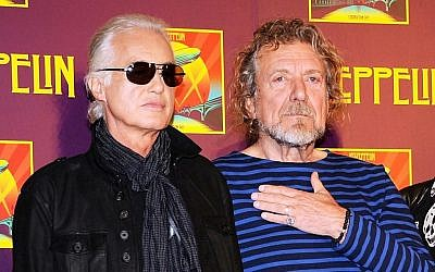 "Led Zeppelin guitarist Jimmy Page, left, and singer Robert Plant appear at a press conference ahead of the worldwide theatrical release of ""Celebration Day,"" a concert film of their 2007 London O2 arena reunion show, in New York, October 9, 2012. (Evan Agostini/Invision/AP)"