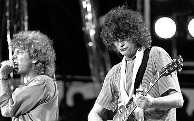 In this July 13, 1985 file photo, singer Robert Plant, left, and guitarist Jimmy Page of the British rock band Led Zeppelin perform at the Live Aid concert at Philadelphia's JFK Stadium. (AP Photo/Rusty Kennedy, File)