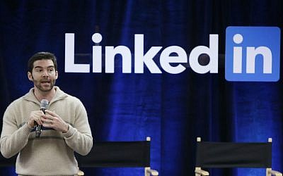 "In this Nov. 6, 2014 file photo, LinkedIn CEO Jeff Weiner speaks during the company's second annual ""Bring In Your Parents Day,"" at LinkedIn headquarters in Mountain View, California. (AP Photo/Marcio Jose Sanchez/File)"