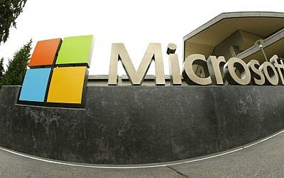 This July 3, 2014 photo shows the Microsoft Corp. logo outside the Microsoft Visitor Center in Redmond, Washington. (AP Photo/Ted S. Warren/File)