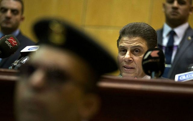 Egyptian judge Mohammed Shirin Fahmy, second right, reads the verdict against former Egyptian President Mohammed Morsi, in a makeshift courtroom at the national police academy, in an eastern suburb of Cairo, Egypt, Saturday, June 18, 2016. (AP Photo/Amr Nabil)
