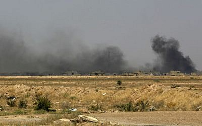 Smoke rises after an airstrike by US-led coalition warplanes as Iraqi security forces advance towards the Shuhada neighborhood of Fallujah, Iraq, Friday, June 3, 2016, during fighting between Iraqi security forces and the Islamic State group. (AP Photo/Khalid Mohammed)