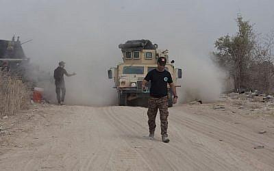 Iraq's elite counterterrorism forces move their vehicles on the front line in Fallujah, Iraq, June 5, 2016. (AP/Maya Alleruzzo)
