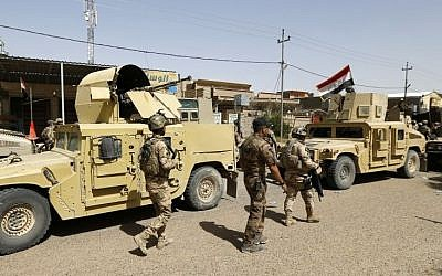 Iraqi security forces enter central Fallujah after fight against Islamic State fighters, Friday, June 17, 2016. (AP Photo)