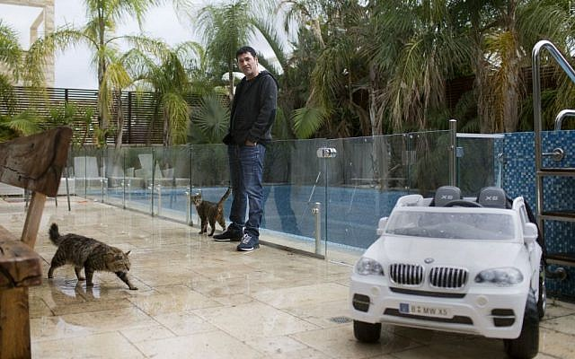 In this March 28, 2016 file photo, Gilbert Chikli, 50, poses for a photo at his home in Ashdod, Israel. (AP Photo/Oded Balilty, File)