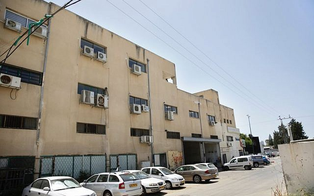 Israeli police say this building served as the headquarters of an international scam operation that duped global companies out of more than $10 million, in the coastal city of Netanya, Israel, Tuesday, June 7, 2016. (AP Photo/Ariel Schalit)