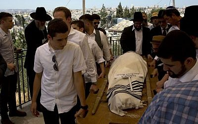 People carry the body of American philanthropist Irving Moskowitz during his funeral in Jerusalem on June 20, 2016. (AP/Sebastian Scheiner)