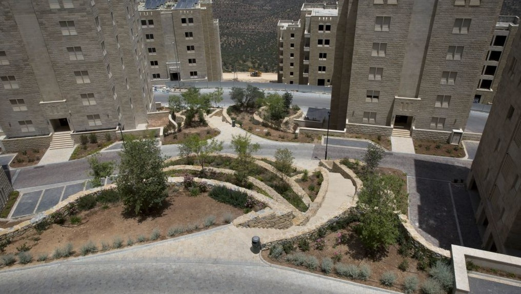 In this June 4, 2016 photo, buildings are under construction in the new West Bank city of Rawabi, north of Ramallah. (AP Photo/Nasser Nasser)
