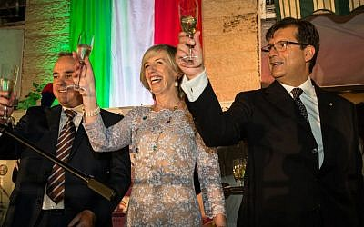 Israeli Minister of Energy Yuval Steinitz (left) raises a glass alongside Italian Minister of Education, Universities, and Research Stefania Giannini and Ambassador Francesco Maria Talò during a Festa della Repubblica celebration at the ambassador's residence in Ramat Gan on June 2, 2016 (Rossella Tercatin/Times of Israel)