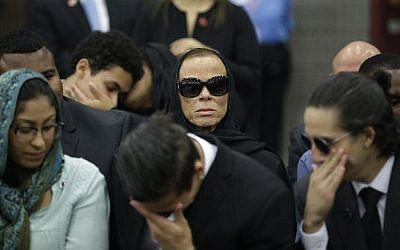 Muhammad Ali's wife, Lonnie (center), attends Muhammad Ali's Jenazah, a traditional Islamic Muslim service, in Louisville, Kentucky, on June 9, 2016. (AP/Darron Cummings)
