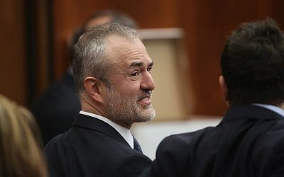 Nick Denton, founder of Gawker, talks with his legal team before Terry Bollea, aka Hulk Hogan, testifies in court during his trial against Gawker Media at the Pinellas County Courthouse on March 8, 2016 in St Petersburg, Florida. (John Pendygraft-Pool/Getty Images)
