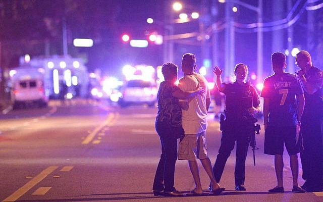 Orlando Police officers direct family members away from a fatal shooting at Pulse Orlando nightclub in Orlando, Florida, June 12, 2016. (AP Photo/Phelan M. Ebenhack, File)