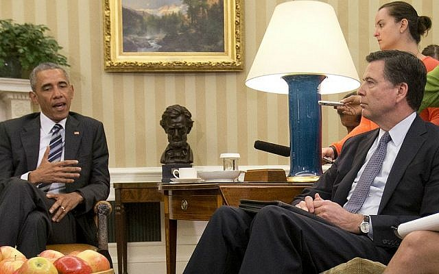 FBI Director James Comey, right, listens to President Barack Obama, left, speak to members of the media in the Oval Office of the White House in Washington, Monday, June 13, 2016, after receiving updates on the Orlando massacre. (AP Photo/Pablo Martinez Monsivais)