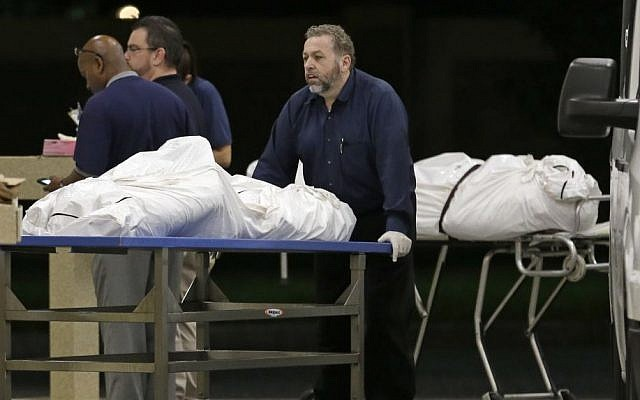 Two bodies of victims arrive at the Orlando Medical Examiner's Office, Sunday, June 12, 2016, in Orlando, Fla. A gunman opened fire inside a crowded gay nightclub early Sunday, killing 49 before dying in a gunfight with SWAT officers, police said. (AP Photo/Alan Diaz)