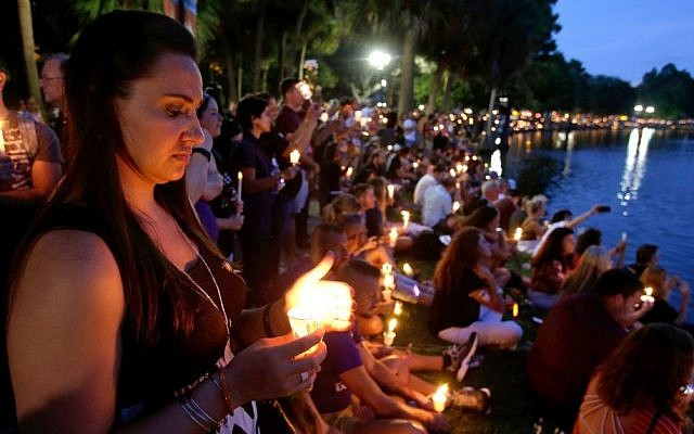 Supporters of the victims of the recent mass shooting at the Pulse nightclub attend a vigil at Lake Eola Park, Sunday, June 19, 2016, Orlando, Fla. Tens of thousands of people attended the vigil. (AP Photo/John Raoux)