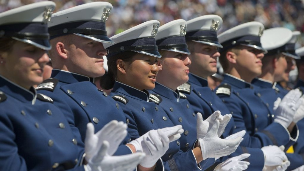 Members of the 2016 class U.S. Air Force Academy applaud as they listen to President Barack Obama deliver the commencement address, Thursday, June 2, 2016, in Colorado Springs, Colo. Obama is giving his final commencement speech to U.S. Air Force Academy graduates who are coming of age at a time of fresh global threats that seem to be pulling the U.S. back into conflicts with uncertain ends. (AP Photo/Pablo Martinez Monsivais)