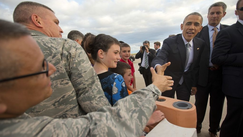 President Barack Obama reaches out to greet members of the military and other guests on the tarmac upon his arrival on Air Force One at Peterson Air Base, in Colorado Springs, Colo., Wednesday, June 1, 2016. (AP Photo/Pablo Martinez Monsivais)