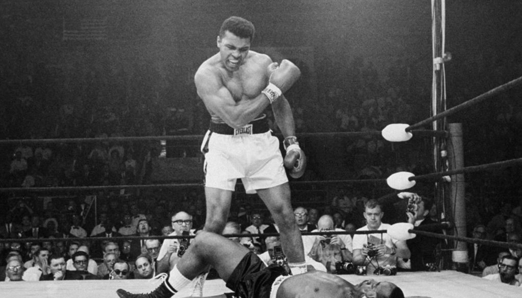 In this May 25, 1965, file photo, heavyweight champion Muhammad Ali, then known as Cassius Clay, stands over challenger Sonny Liston, shouting and gesturing shortly after dropping Liston with a short hard right to the jaw, in Lewiston, Maine. (AP Photo/John Rooney, File)