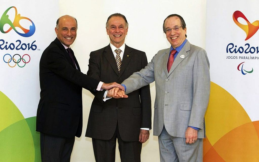 The Jewish trio in charge of the Rio Olympics: Carlos Arthur Nuzman flanked by Sidney Levy, left, and Leonardo Gryner, Nov. 9, 2012. (Marcio Rodrigues/via JTA)