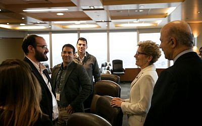 Canada's Premier of Ontario Kathleen Wynne and Ontario Minister of Research and Innovation Reza Moridi speak with The Time of Israel's Judah Ari Gross and other Israeli reporters in Toronto on May 2, 2016. (Nabil Shash/Government of Ontario)