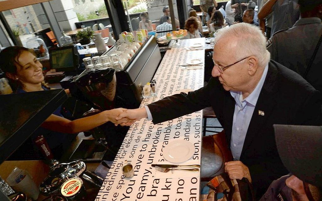 President Reuven Rivlin visit the Sarona Market shopping center in Tel Aviv on June 9, 2016, the morning after a deadly terror attack at the site. (Mark Neiman/GPO)