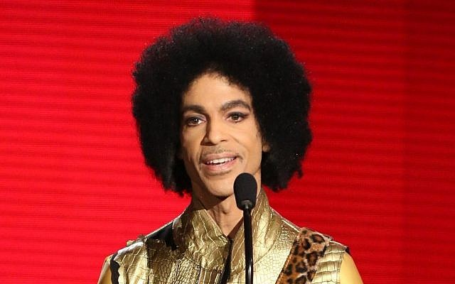In this Nov. 22, 2015 file photo, Prince presents the award for favorite album - soul/R&B at the American Music Awards in Los Angeles. (Matt Sayles/Invision/AP)