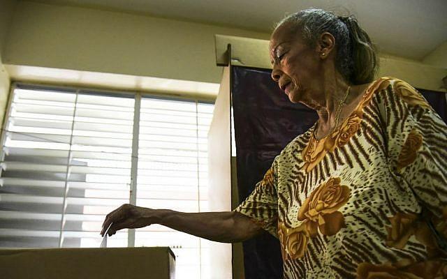 Puerto Rico resident Judith Perez Alvarez casts her ballot during the US territory's Democratic primary election at the Luis Llorens Torres Elementary School in San Juan, Puerto Rico, Sunday, June 5, 2016. (AP Photo/Carlos Giusti)